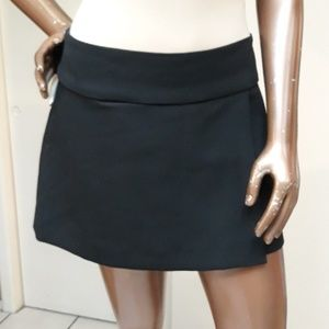 NWOT Bebe Black Crossover Mini Skirt